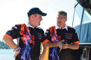 Rick Merola (right) talks details with transport specialist Milton Calafell, who has been with the team since 2007